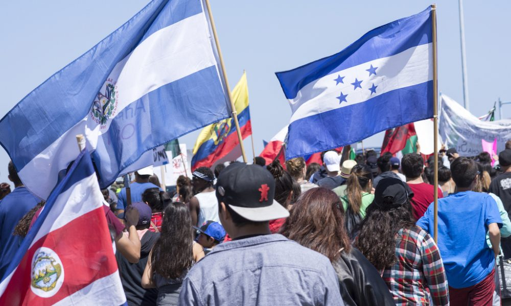 SAN DIEGO, USA - MAY 27, 2016: Protesters gather to march against Donald Trump outside a Trump rally in San Diego while carrying flags from Costa Rica, El Salvador, Honduras and other Central American nations.